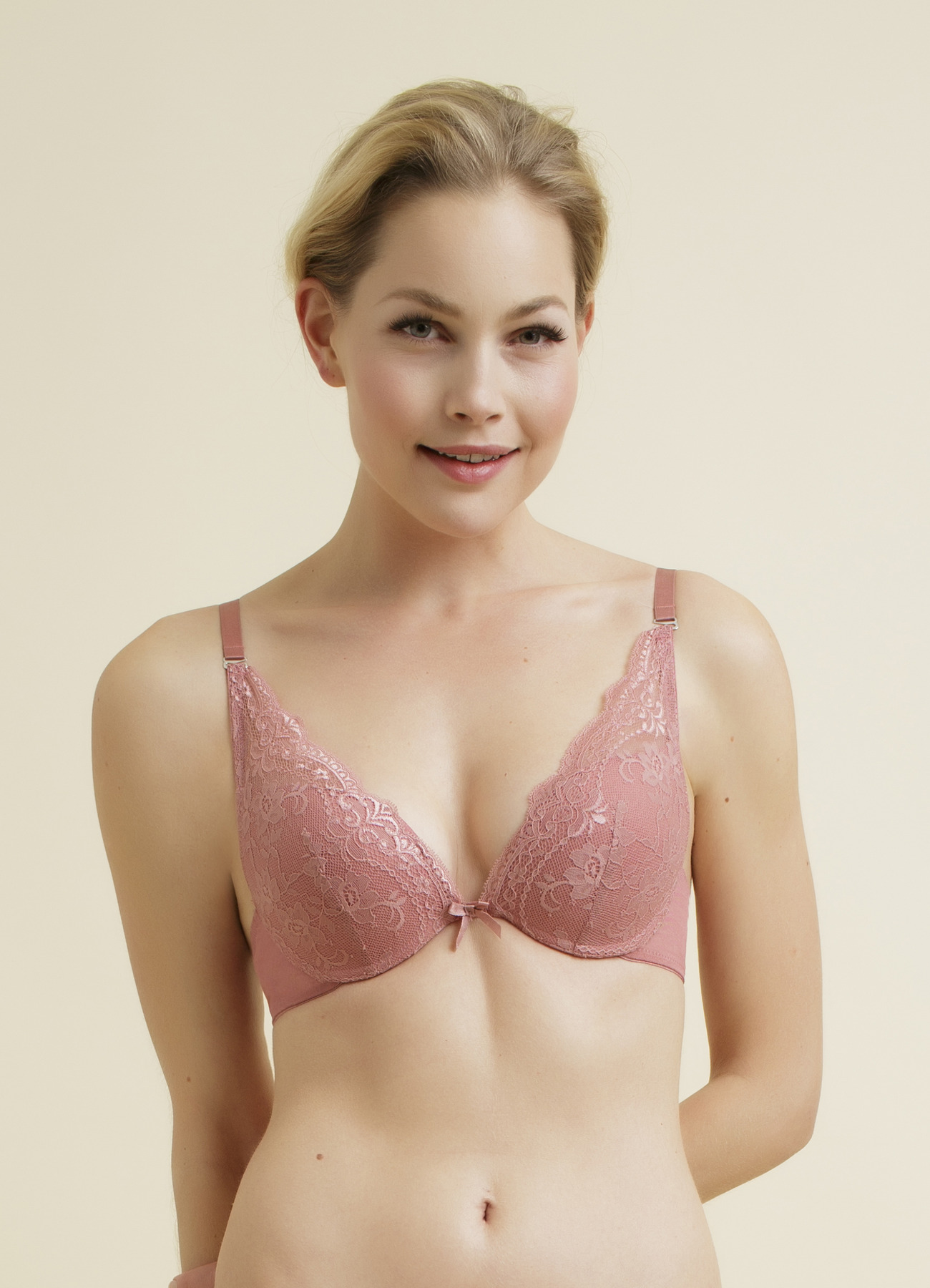 I love this bra. I own several. A size large fits perfect for my usual size 36 D. I's very soft but great support. Just enough lining in the cups to prevent show through.